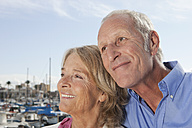 Spain, Mallorca, Palma, Senior couple at harbour, smiling - SKF000825