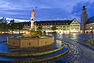 Germany, Baden Wurttemberg, Freudenstadt, View of Guildhall with fountain at night - WDF001139