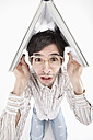 Young man with crazy glasses and book, portrait - MAEF004208
