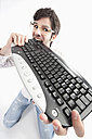 Young man with crazy glasses and keyboard, portrait - MAEF004209