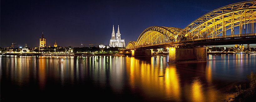 Germany, Cologne, View of Cologne Cathedral and Hohenzollern Bridge with River Rhine - FOF003818