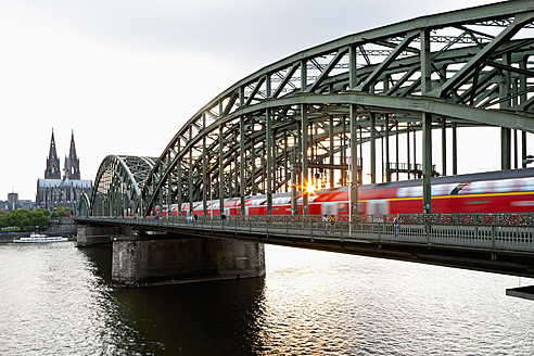 Germany, Cologne, View of Cologne Cathedral and Hohenzollern Bridge with River Rhine - FO003819