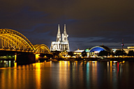 Germany, Cologne, View of Cologne Cathedral and Hohenzollern Bridge with River Rhine - FOF003822