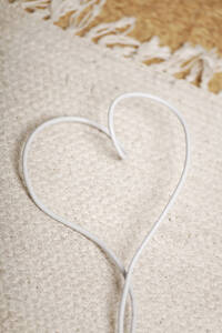 Germany, Heart shape cable on mat - ANBF000006