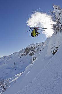 Austria, Tyrol, Kitzbuhel, Mid adult man skiing - FFF001268