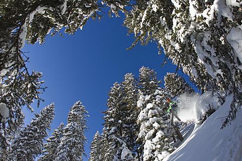 Austria, Tyrol, Kitzbuhel, Mid adult man skiing - FFF001270