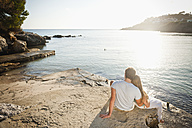 Spain, Mallorca, Couple sitting on beach - MFPF000010