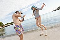 Spain, Mallorca, Couple taking pictures on beach - MFPF000031