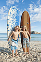 Spain, Mallorca, Children with surfboard on beach - MFPF000076