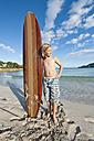 Spain, Mallorca, Boy with surfboard on beach - MFPF000079