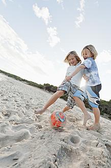 Spain, Mallorca, Children playing soccer on beach - MFPF000082