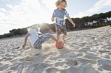 Spain, Mallorca, Children playing soccer on beach - MFPF000085