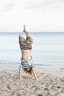 Spain, Mallorca, Boy playing on beach - MFPF000091