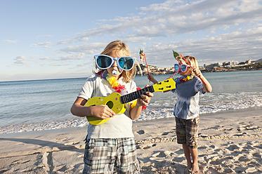 Spain, Mallorca, Children playing on beach - MFPF000100