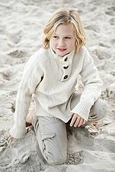 Spain, Mallorca, Boy sitting on beach - MFPF000103