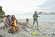 Spain, Mallorca, Friends at camp fire on beach - MFPF000106