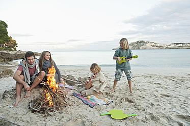 Spain, Mallorca, Friends at camp fire on beach - MFPF000106