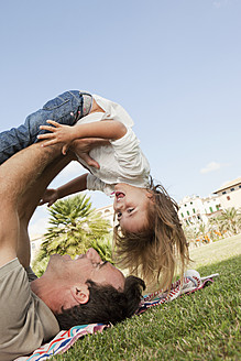 Spain, Mallorca, Palma, Father and daughter playing, smiling - SKF000903