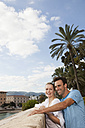 Spain, Mallorca, Palma, Couple looking away, smiling - SKF000930