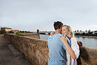 Spain, Mallorca, Palma, Couple hugging at harbour, smiling - SKF000936