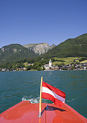 Austria, Boat with flag in Wolfgangsee Lake - WWF001968