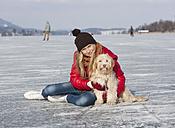 Austria, Teenage girl with dog, smiling, portrait - WWF002288