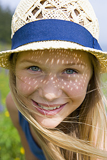 Austria, Teenage girl smiling, portrait - WWF002232