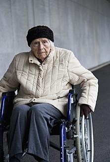 Austria, Senior woman on wheelchair at Subway - WWF002029