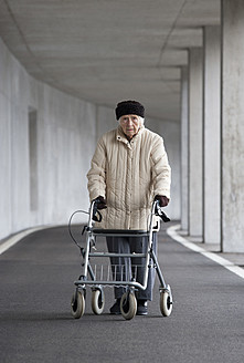 Austria, Senior woman with wheeled walker at Subway - WWF002033