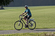 Germany, Bavaria, Mature man riding electric bicycle - DSF000250