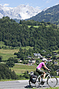 Austria, Salzburger Land, Mid adult woman riding bicycle - DSF000259