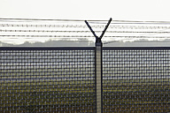 Germany, Frankfurt, View of security fence at airport - THF001149