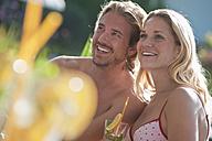 Austria, Salzburg County, Couple with drink near pool - HHF003999