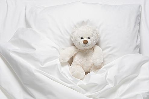 Teddy bear on bed - CRF002115