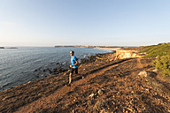 Portugal,Algarve,  Mature man jogging by coast - MIRF000367