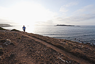 Portugal,Algarve,  Mature man jogging by coast - MIRF000373