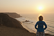 Portugal, Algarve, Senior woman looking at sunrise - MIRF000376