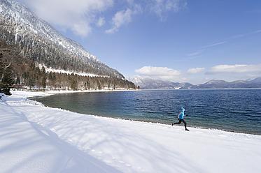 Germany, Bavaria, Mature man jogging by Walchensee Lake - MIRF000379