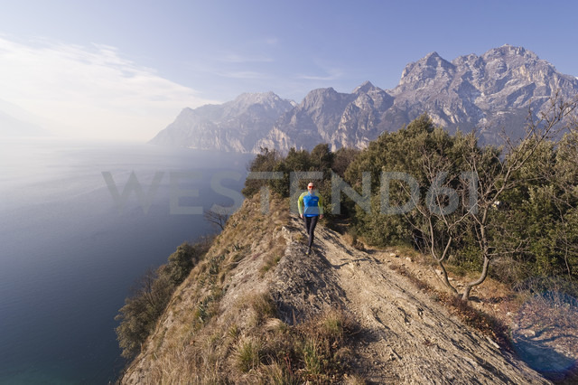 Italy, Mature man jogging by Lake Garda - MIRF000394