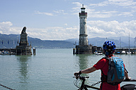 Germany, Bavaria ,Lindau, Lake Constance,  Mature man looking at harbour - DSF000230
