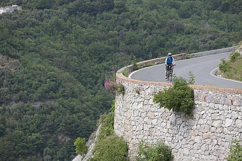 Italy, Liguria, Provinvce of Savona, Mature man riding bicycle - DSF000359