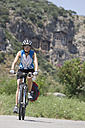 Turkey, Kaunos, Mid adult woman riding bicycle - DSF000361