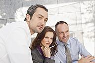 Germany, Leipzig, Business people looking away - WESTF018520
