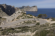 Spain, Mallorca, Man and woman cycling on road at Cap de Formentor - DSF000412