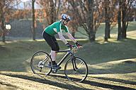 Germany, Bavaria, Munich, Mature man riding bicycle - DSF000525