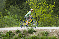 Germany, Bavaria, Munich, Mature man riding bicycle - DSF000470