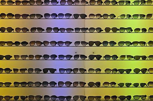 Germany, Row of sunglasses in showcase - AXF000044