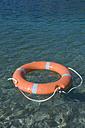 Germany, Bavaria, Lifesaver floating on Lake Starnberg - CRF002154