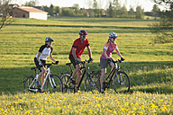 Germany, Bavaria, Man and women riding bicycle - DSF000555