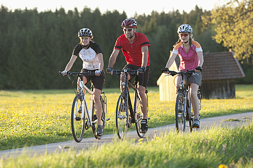 Germany, Bavaria, Man and women riding bicycle - DSF000553